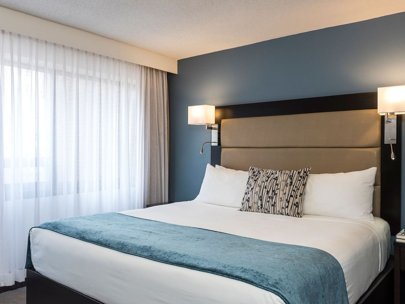 room with bed and wall lamps