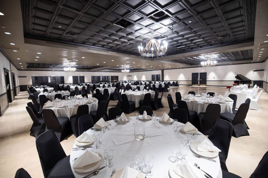 tables and chairs in a large even room