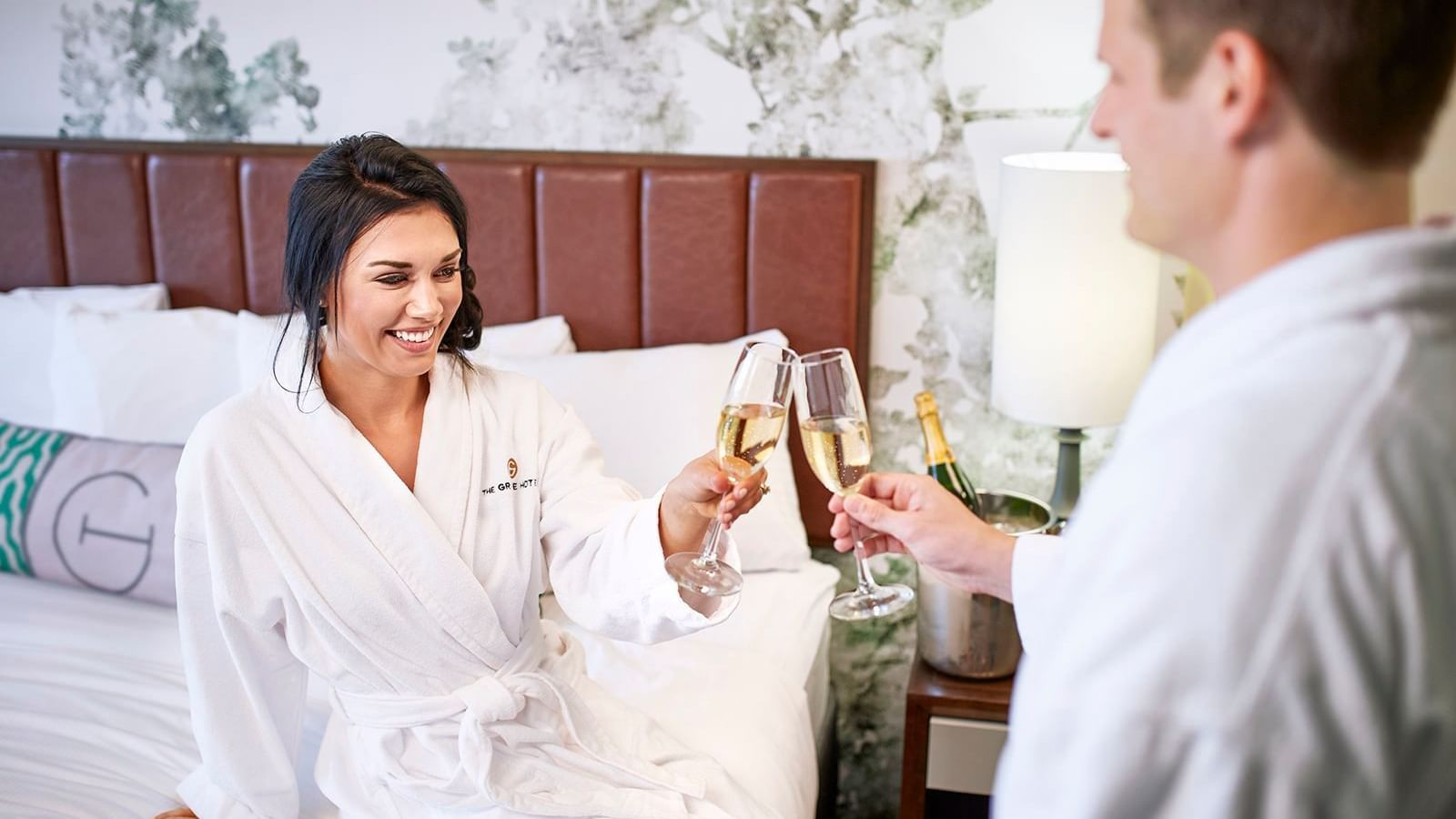two people drinking champagne