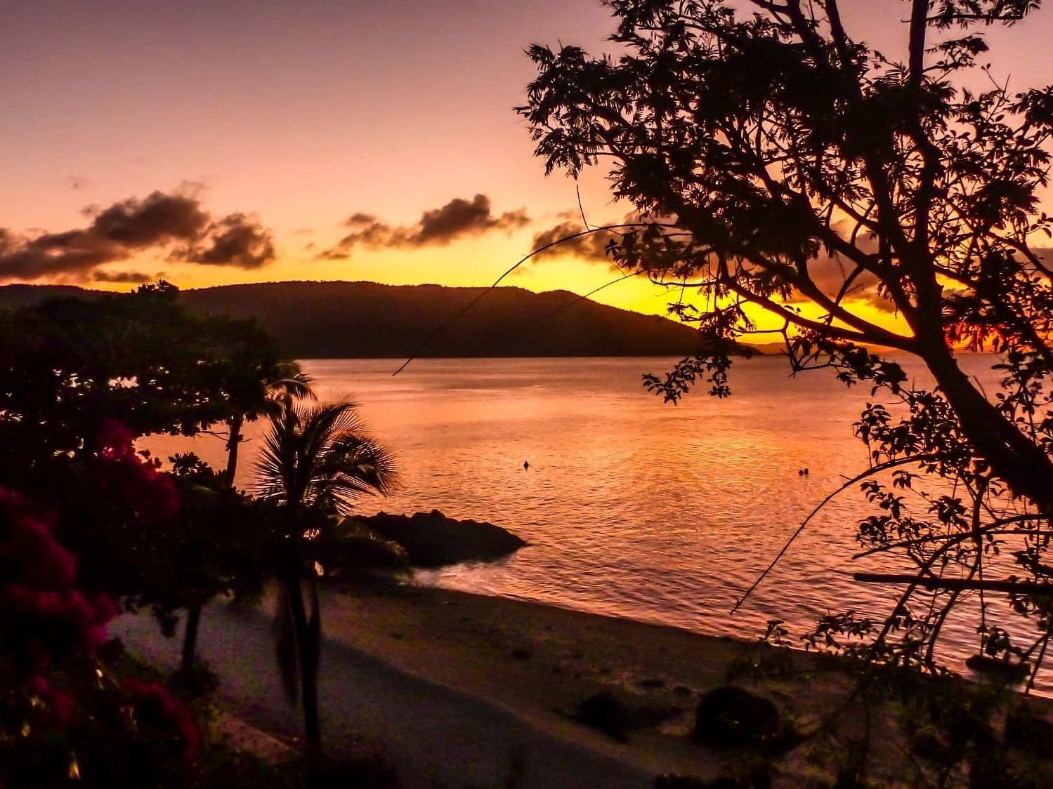 Sunset view from Lovers cove bar at Daydream Island Resort