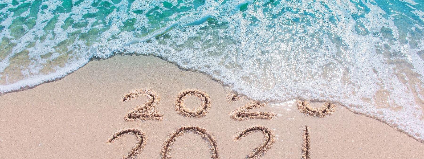 2021 written on beach at Daydream Island Resort