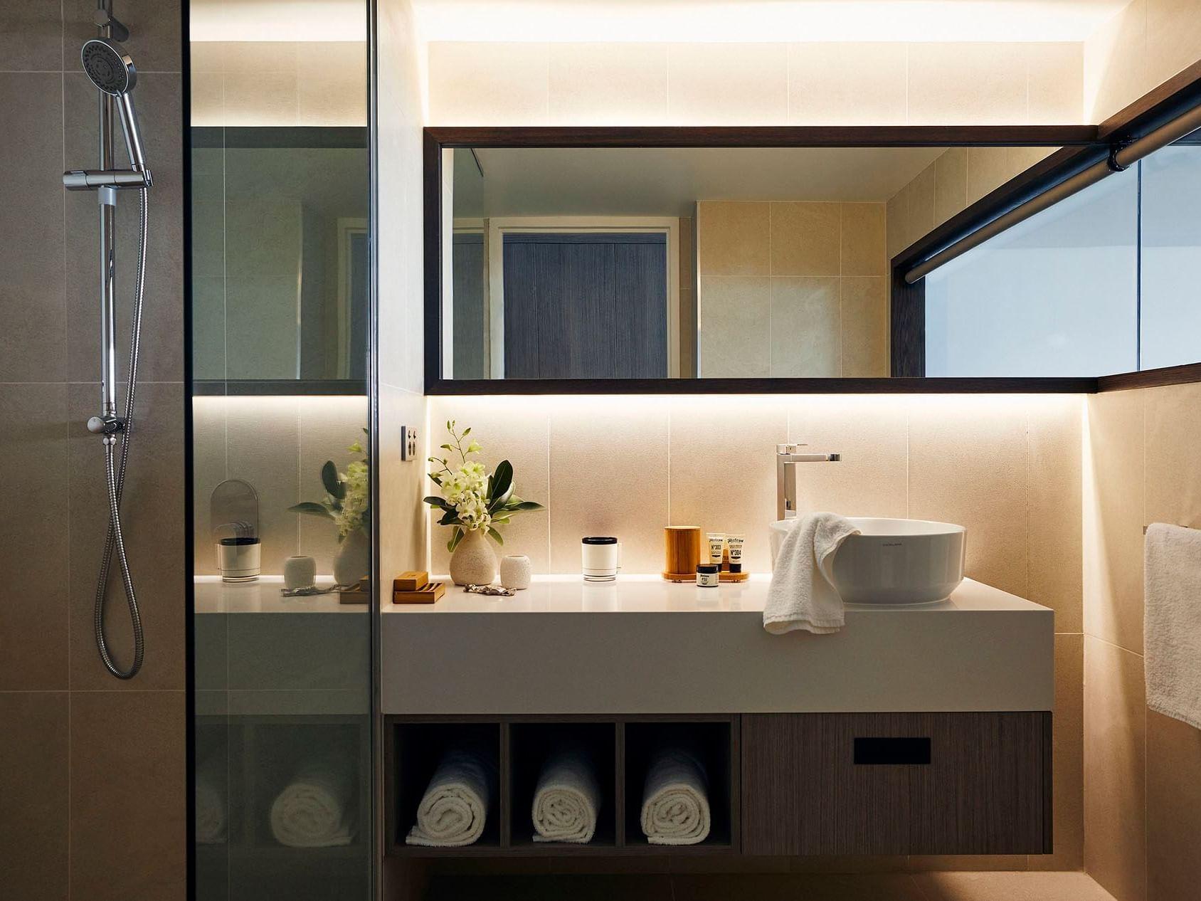 Bathroom in Deluxe Ocean Terrace room at Daydream Island Resort