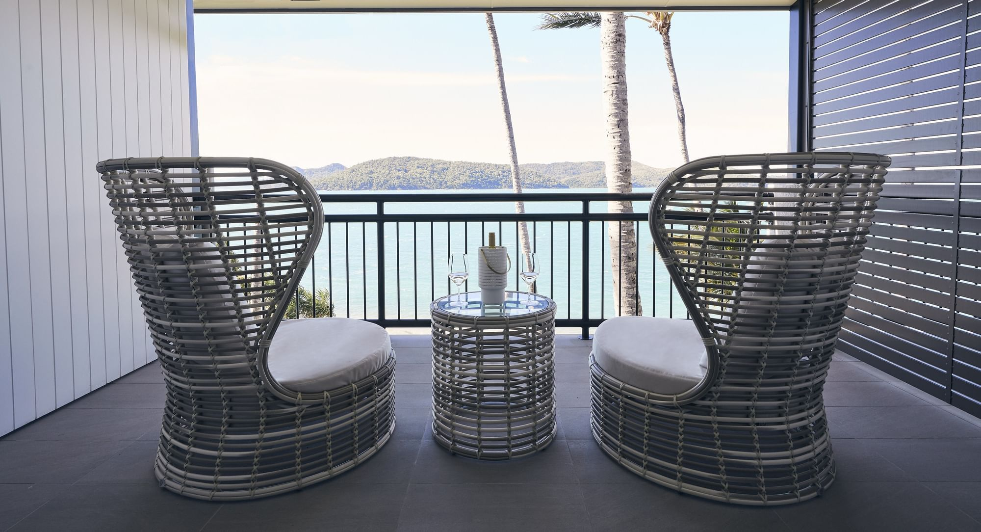 Comfy chair on terrace in deluxe room at Daydream Island Resort