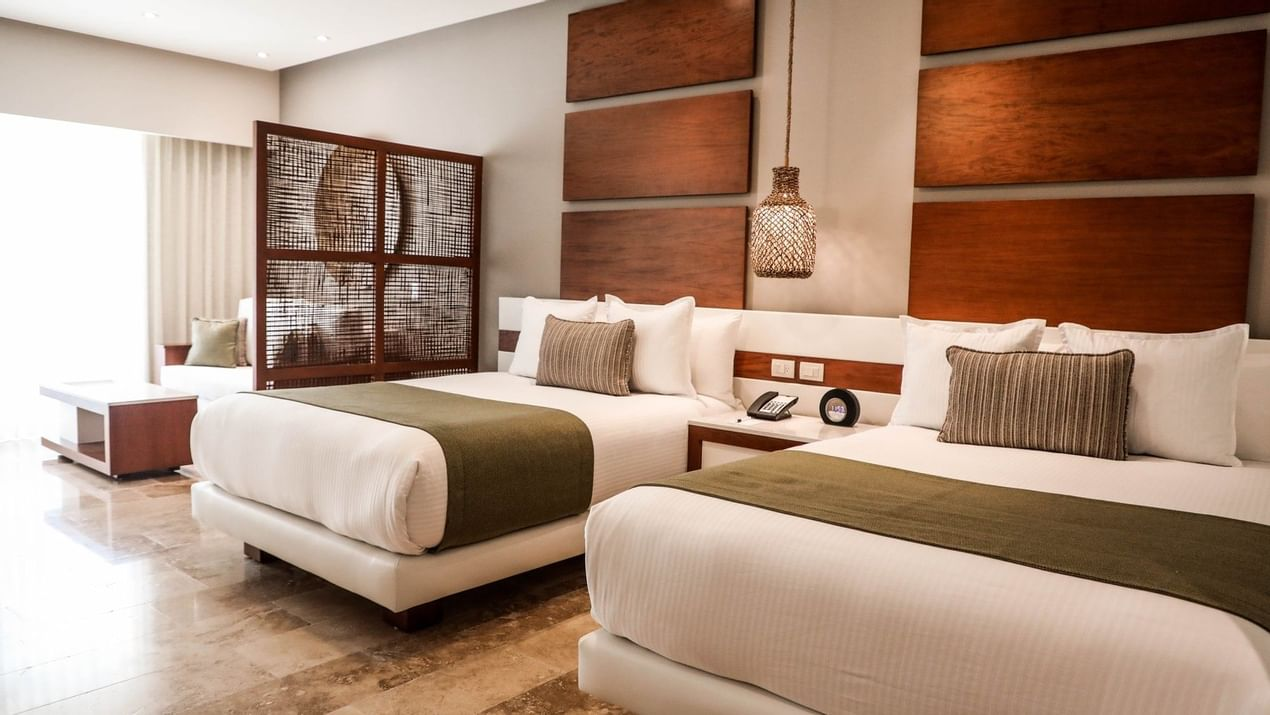 Two comfy single beds in Deluxe Junior Suite at The Reef 28