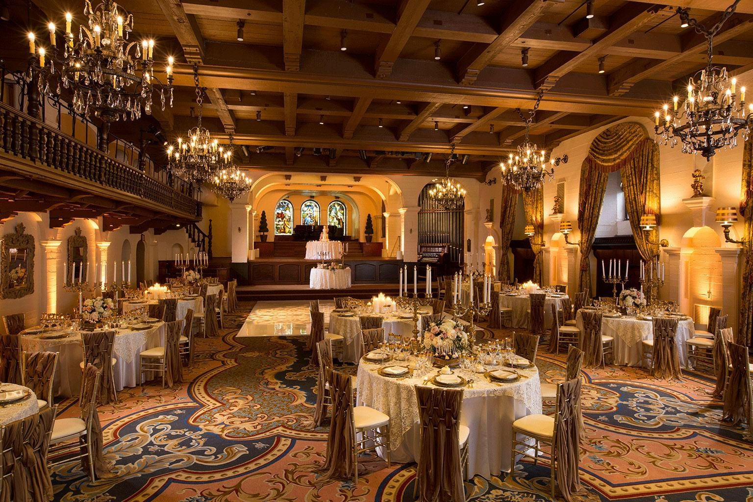 grand parisian ballroom with chandeliers and decorated tables