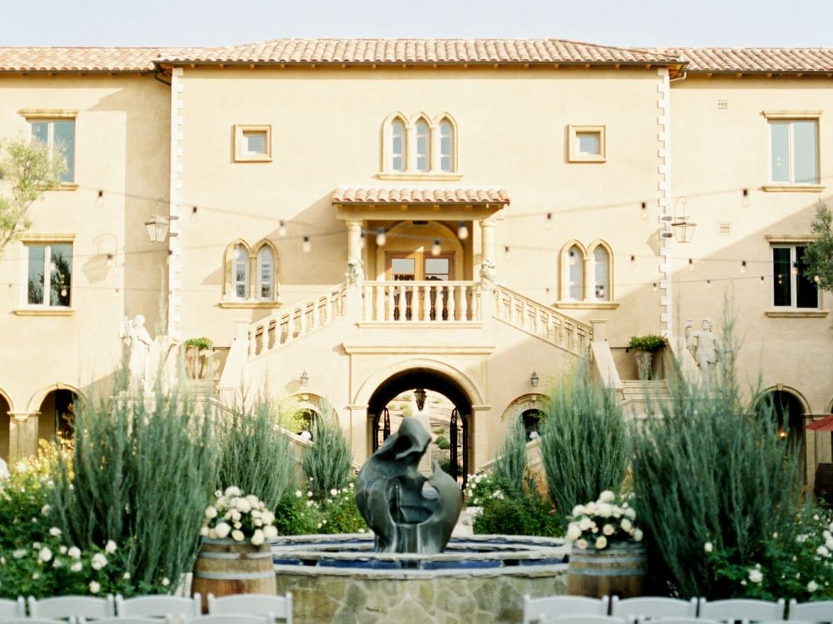 The center courtyard fountain with chairs set, ready for a wedding.
