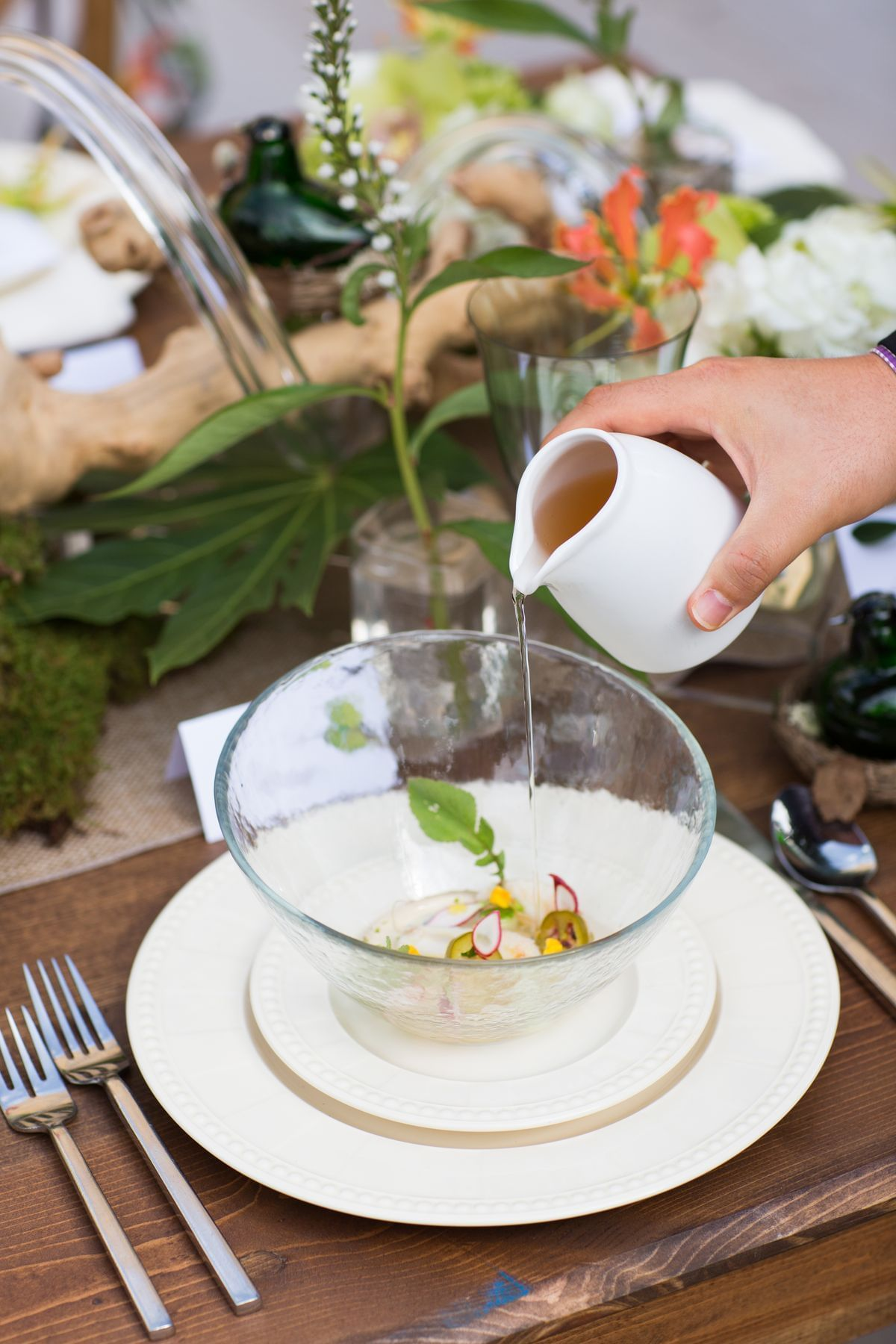 pouring liquid onto fancy dish