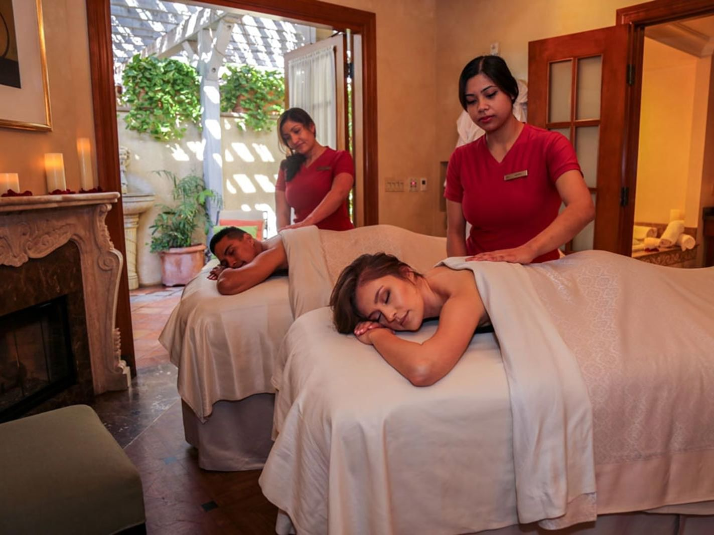 A couple getting massages at the Spa in Kelly's Spa & Boutique