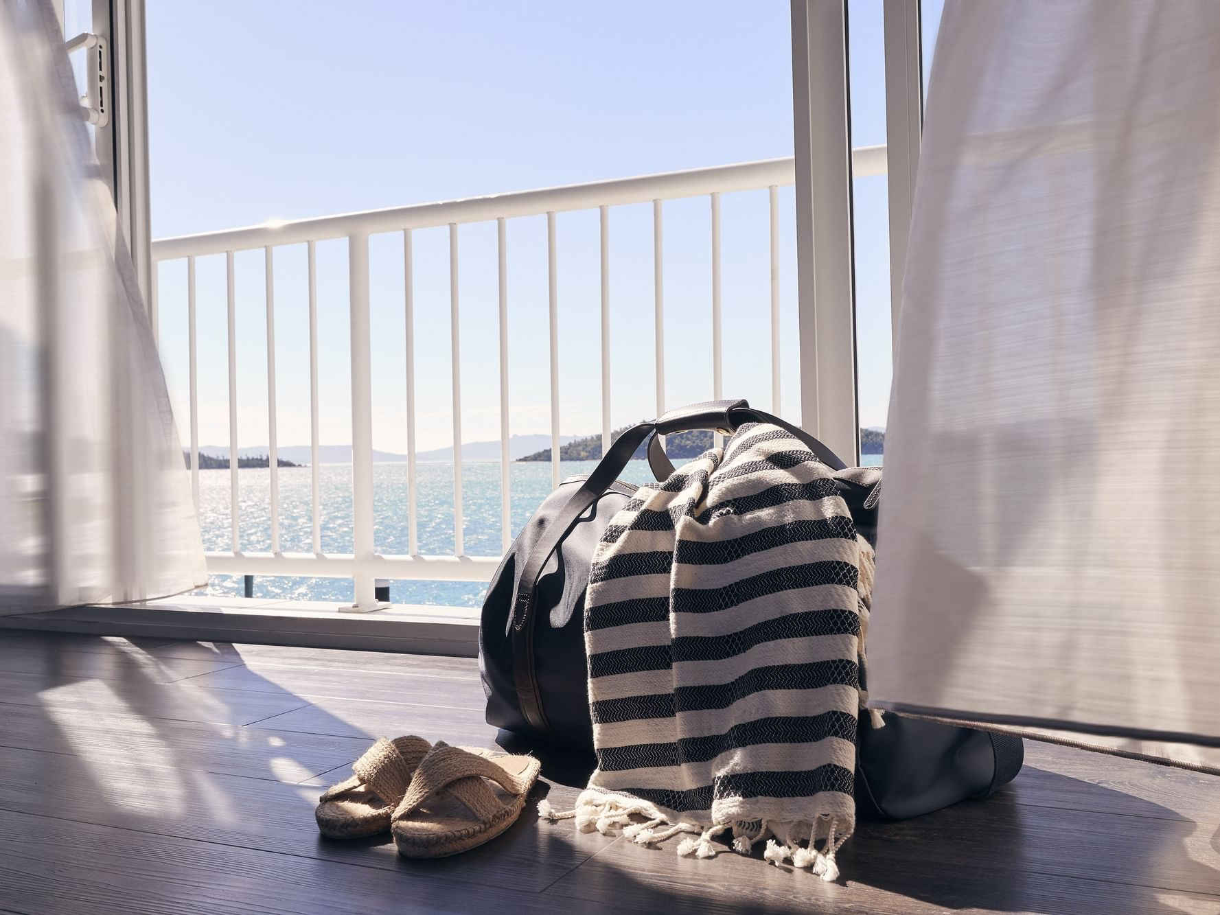 Tourist luggage in Superior room at Daydream Island Resort