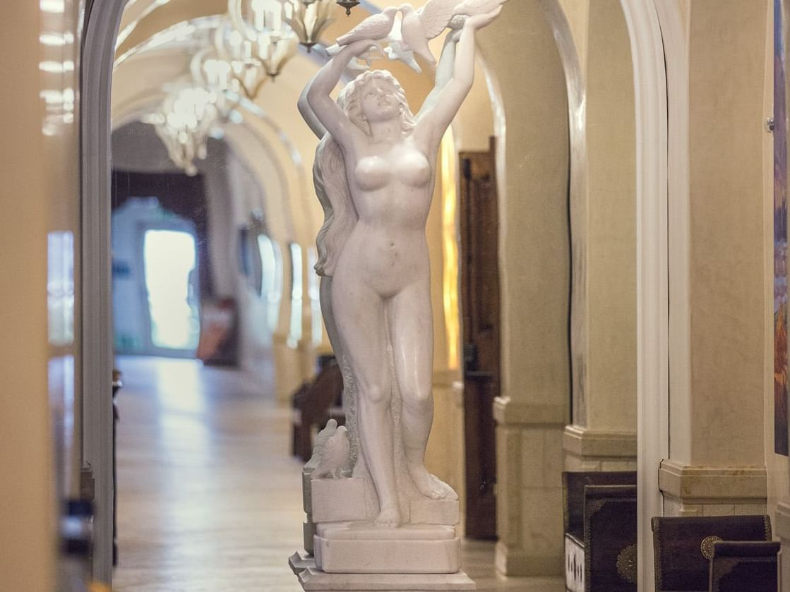 Statue with hallway in mirror reflection