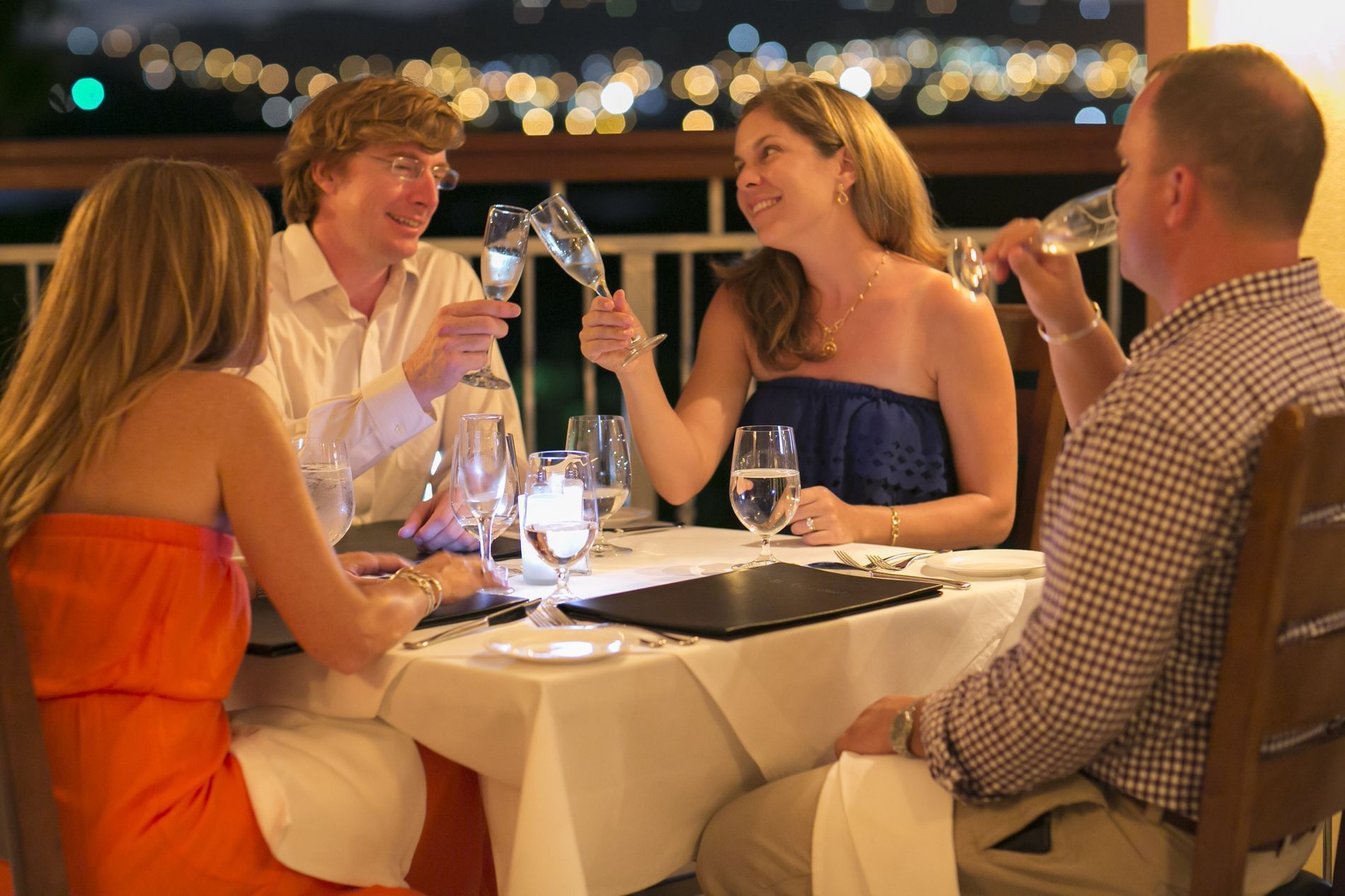 Two couples dining together