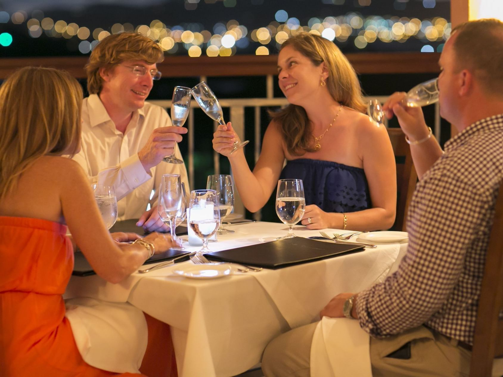 Two Couples Dining Outdoors
