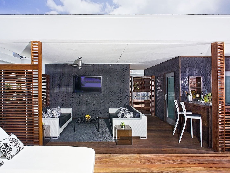 Sun House living & bar area with sunbeds at Dream South Beach