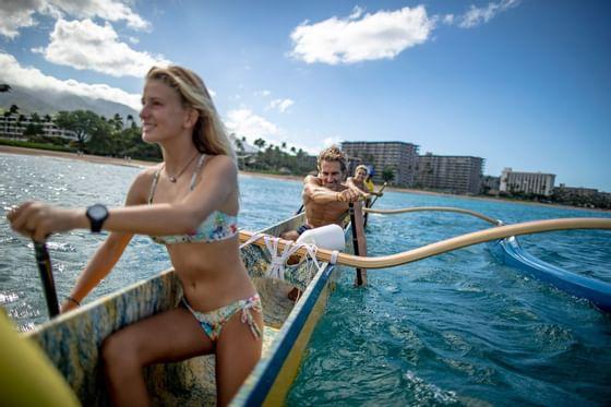 woman and man kayaking in ocean