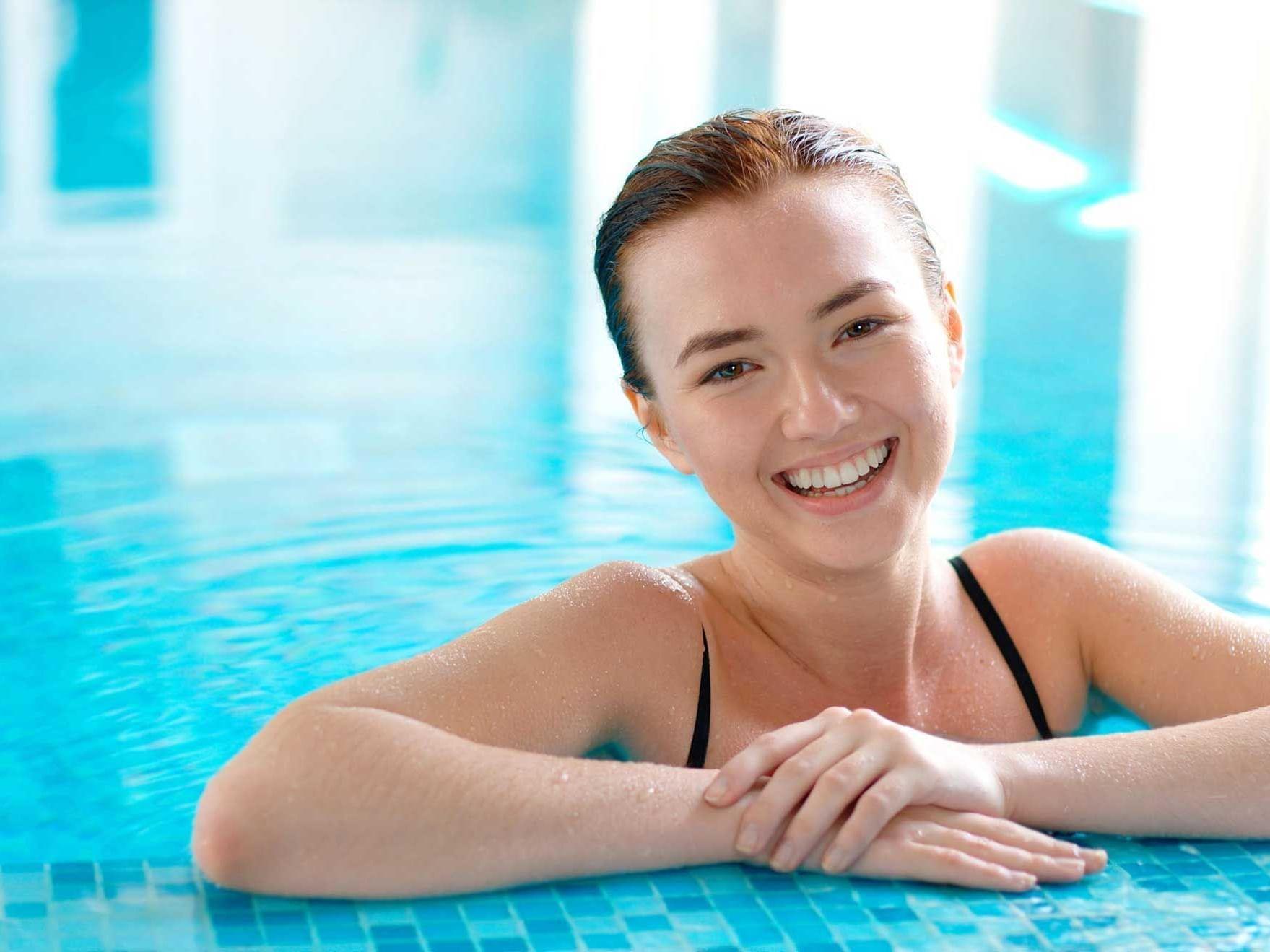 Lady smilling in swimming pool at Artyzen Grand Lapa Hotel Macau