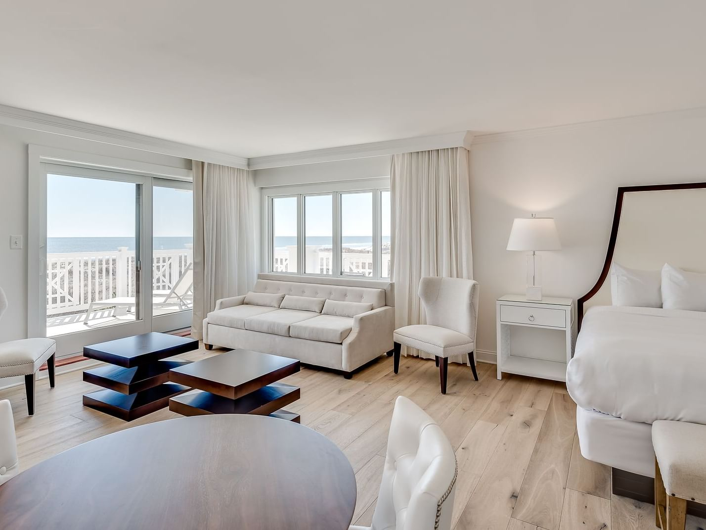 ICONA Avalon Side Oceanfront Luxury King Studio dining, living & sleeping area with large wrap around ocean front balcony