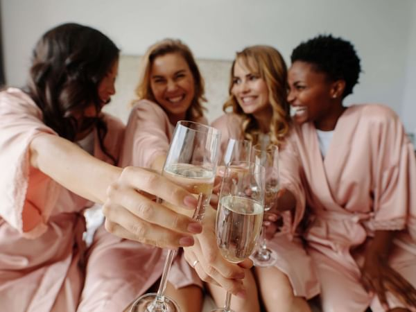 Four woman toasting with champagne at Holiday Inn Montego Bay