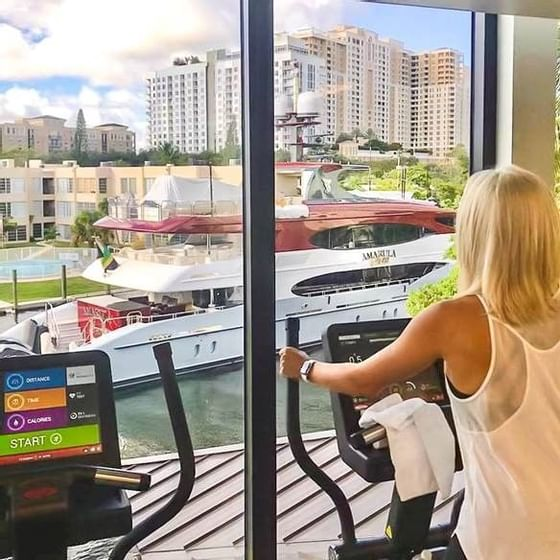 woman on fitness equipment overlooking river