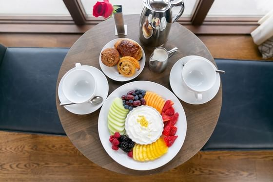 Fruit plate and breakfast pastries from above