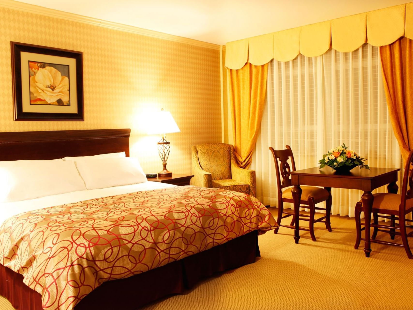 Bed and dining table in hotel room