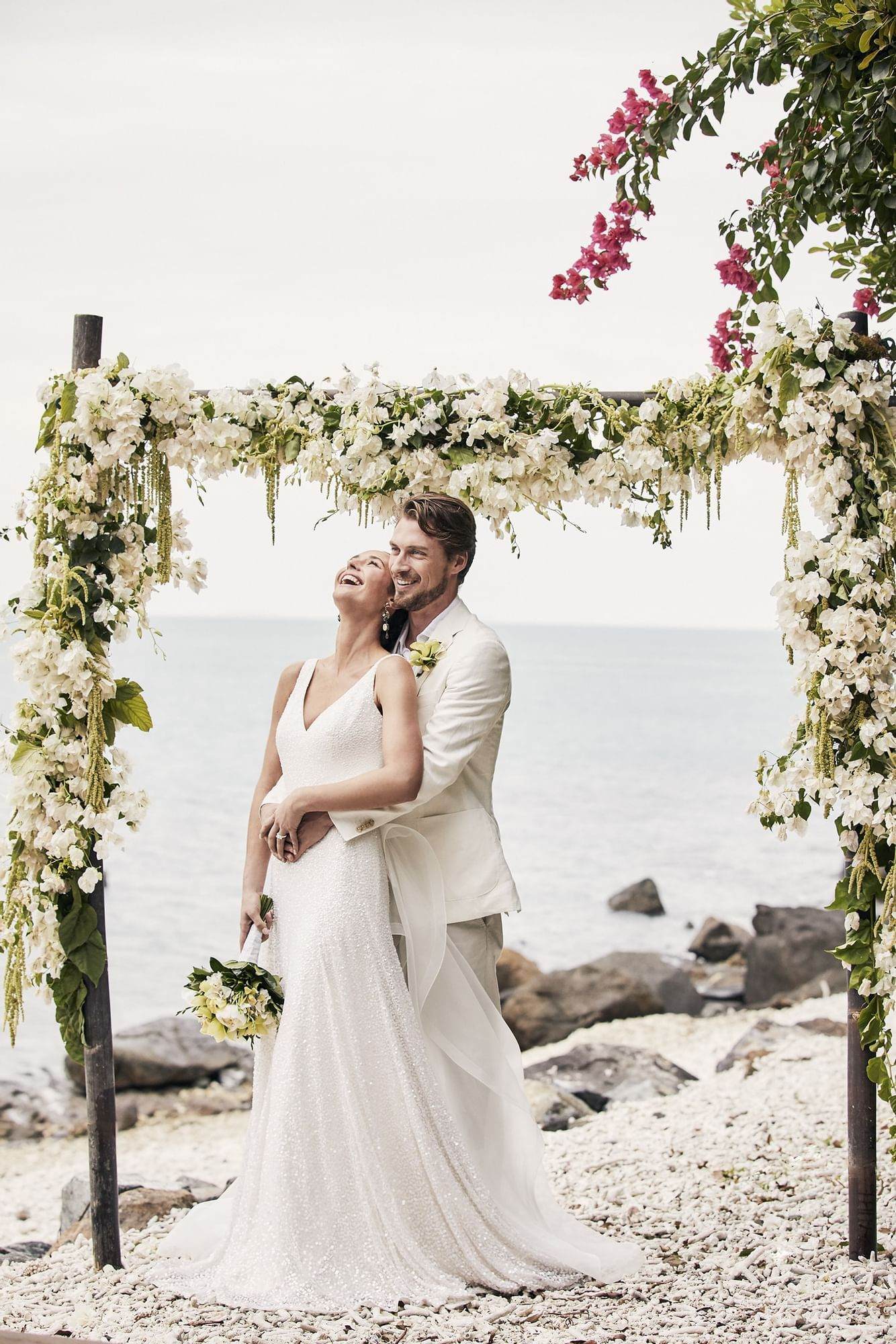 Wedded couple with flower decorations at Daydream Island Resort
