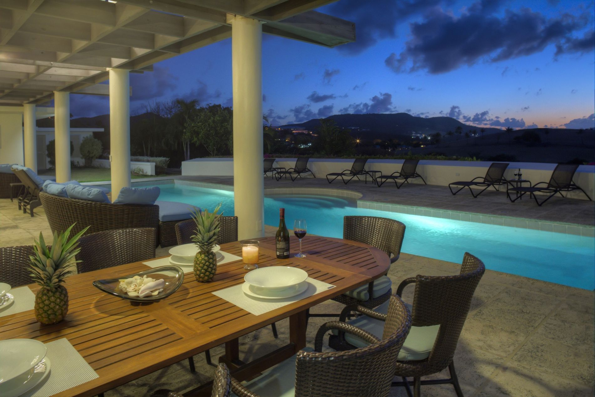 Dining Table on Deck By Outdoor Pool at Dusk
