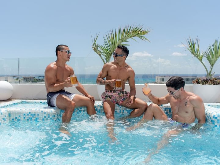 Friends having drinks in pool at The Reef 28