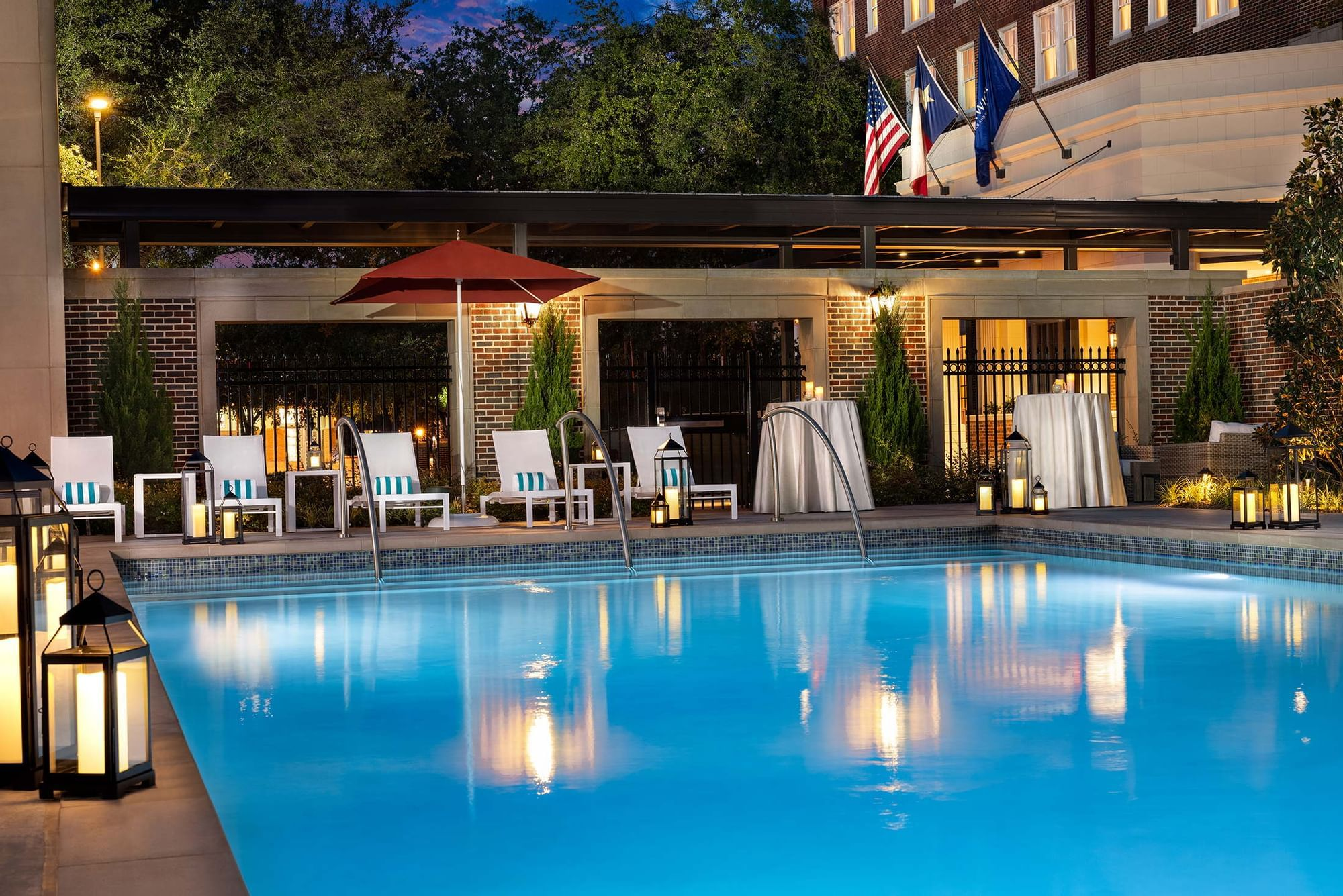 Warwick Melrose Dallas swimming pool evening cocktail