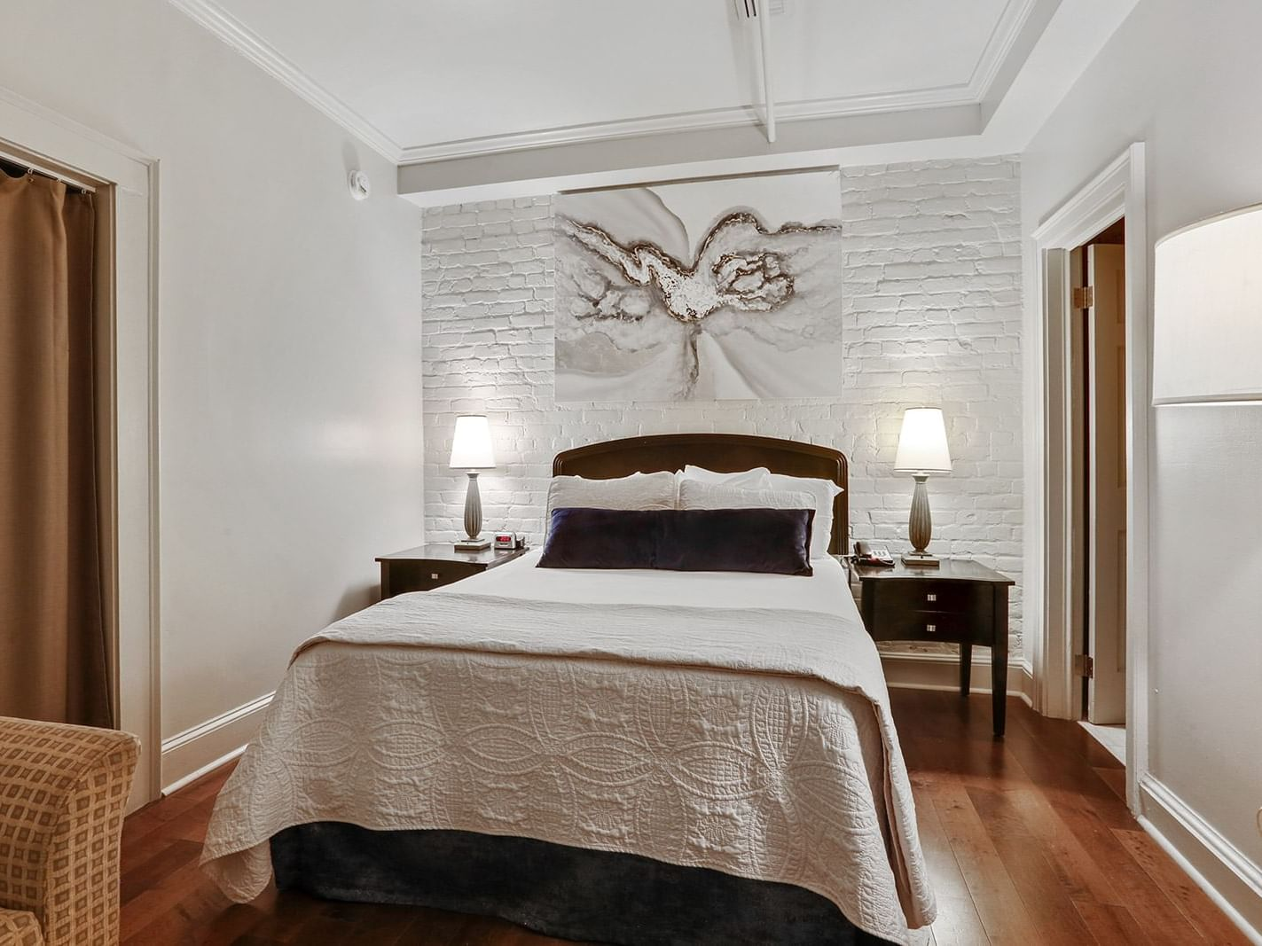 Intimate Queen Bed Room with one bed at La Galerie Hotel