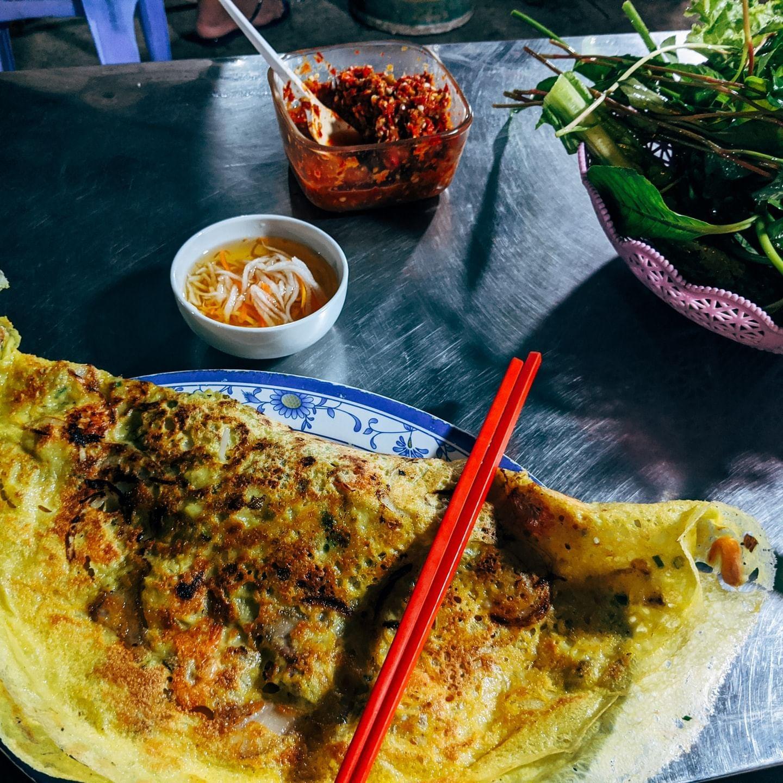 vietnamese pancake with red chopsticks