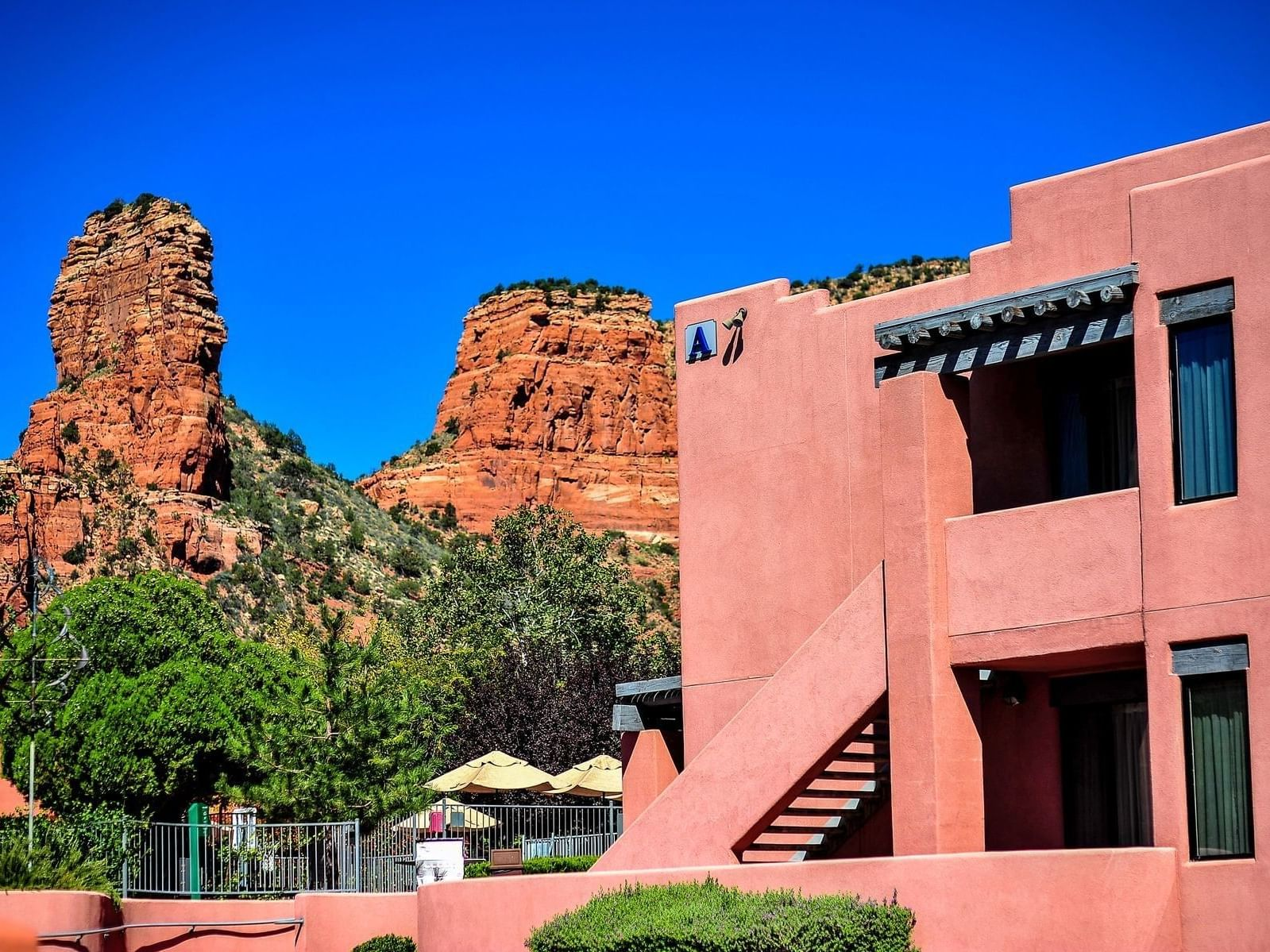 Exterior view of the of Diamond Sedona Portal Hotel with the view of mountains