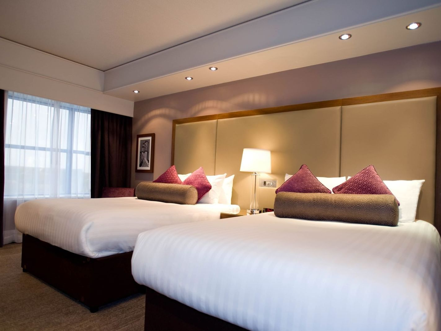 The Two Double Beds Room at Sandman Signature London Gatwick Hotel with two double beds (with premium pillow-top) and lamp shade between the beds