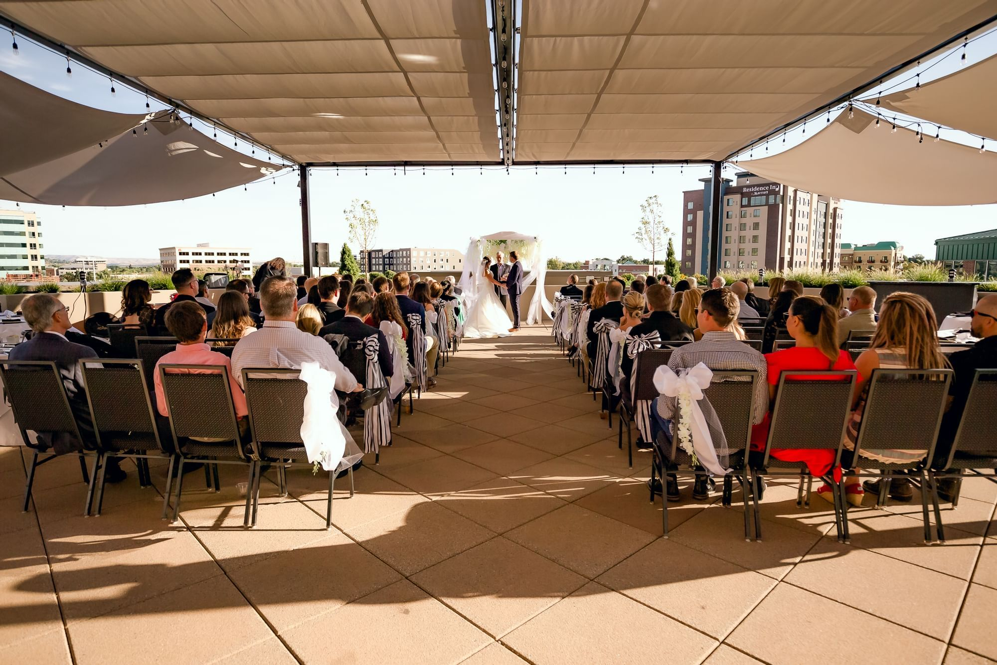 rows of people at a wedding ceremony