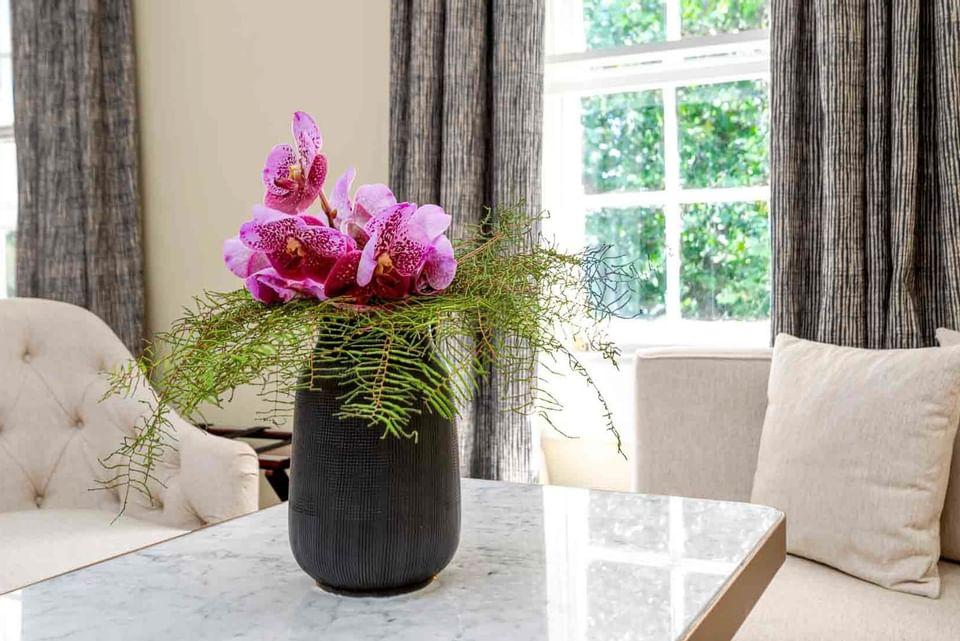 A Flowerpot on a table in Courtyard Double at The Relais Henley