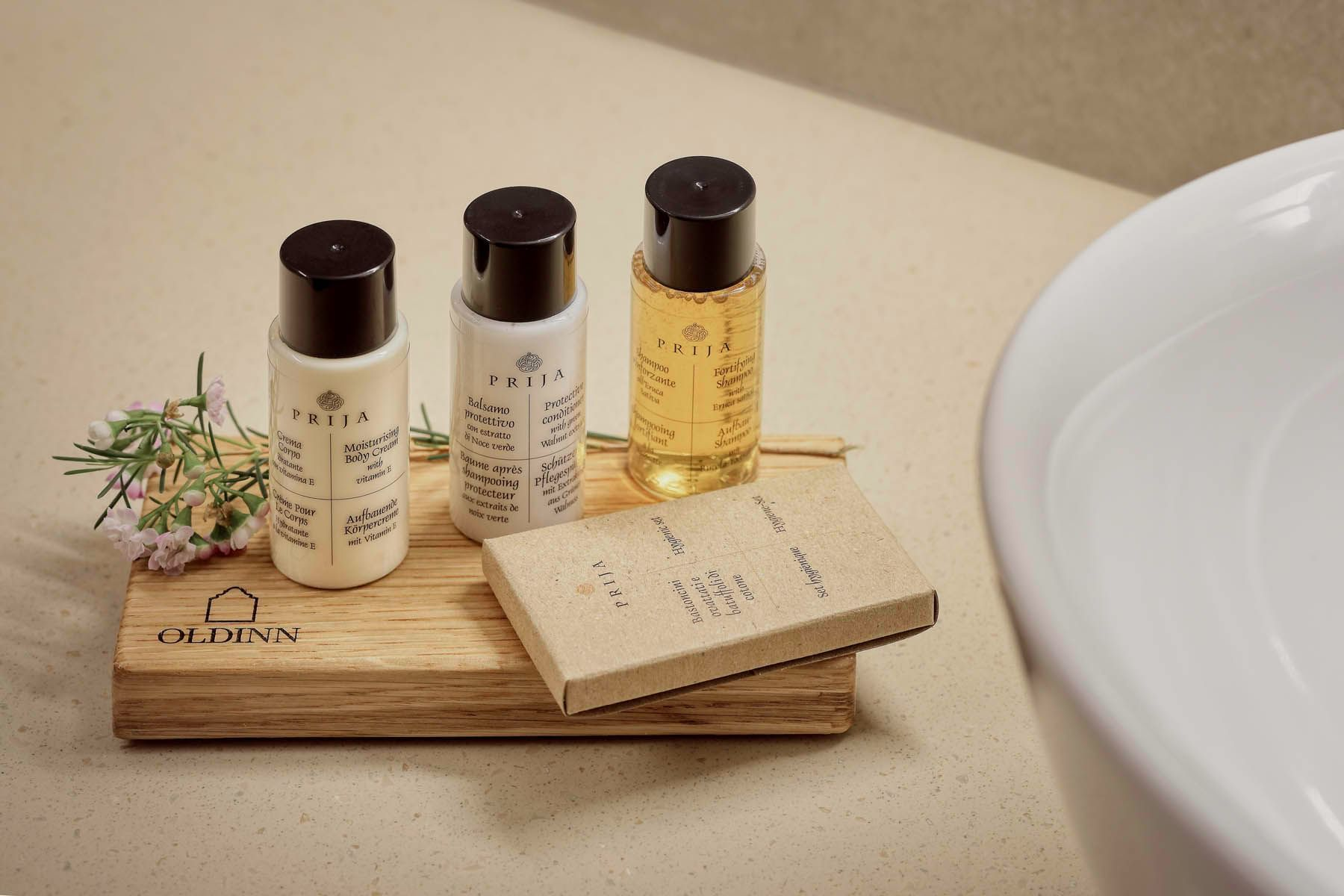 set of different soaps in bathroom at Hotel Old Inn, Double Bed,