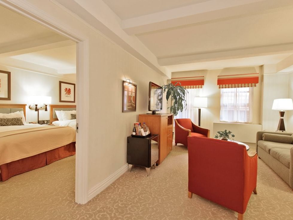 Hotel suite with bedroom and living room