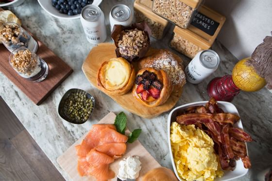 breakfast display with eggs, bacon and fruit