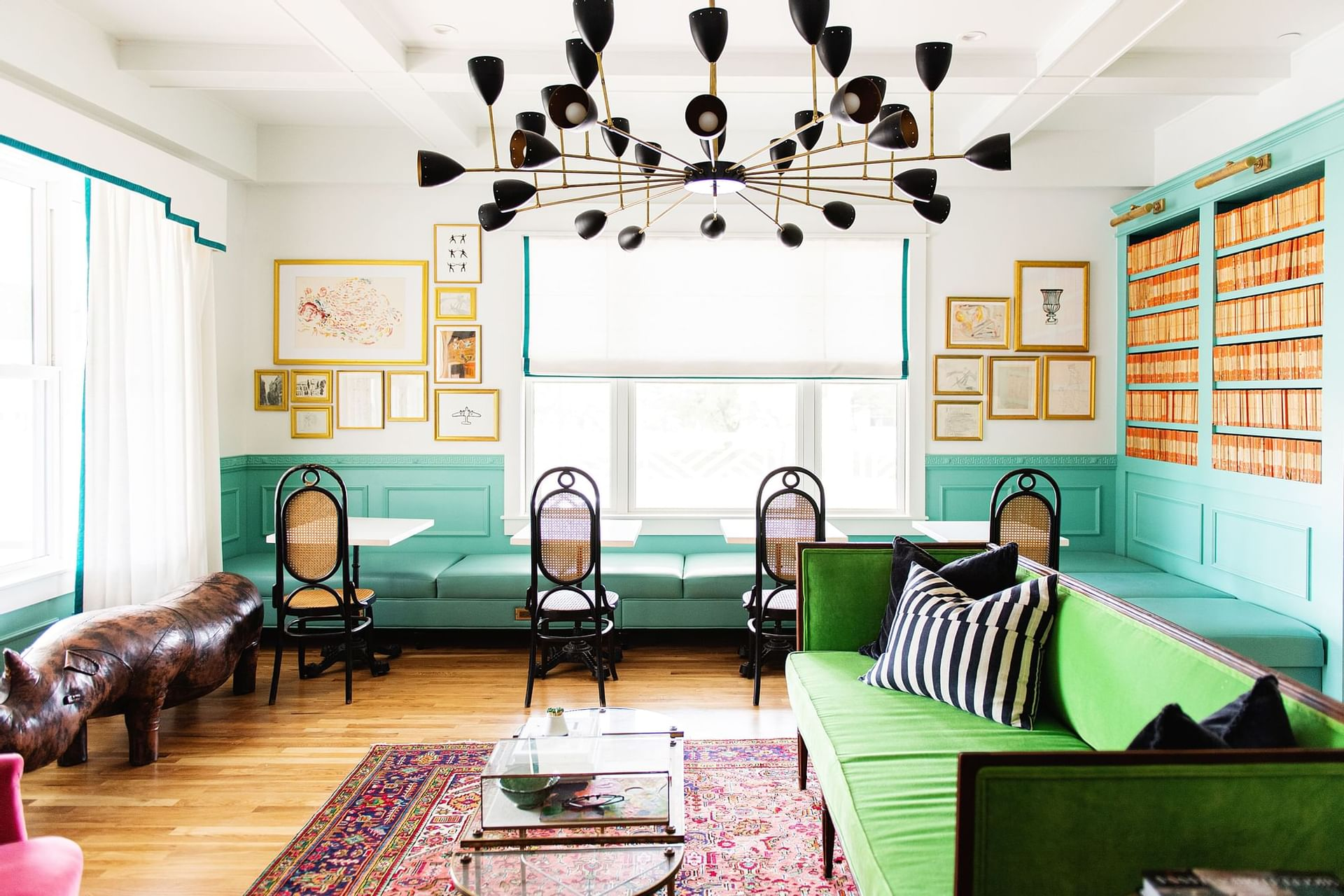spacious room with blue walls, green couch and chairs