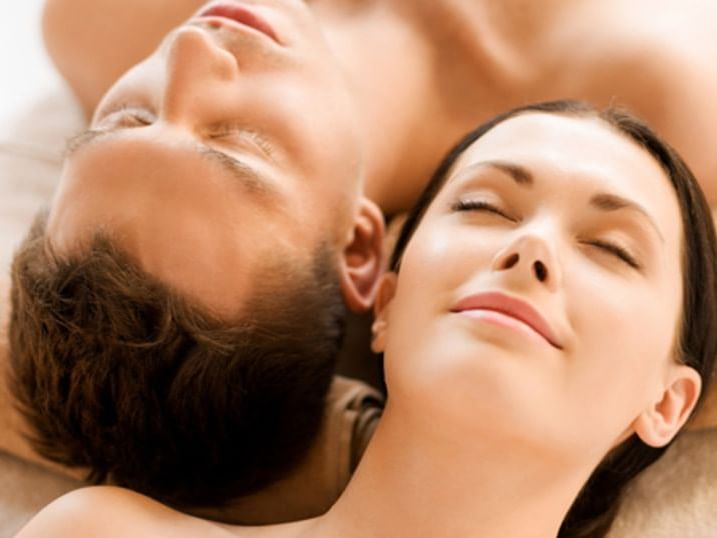 A couple relaxing in the spa at Ana Hotels Bradul