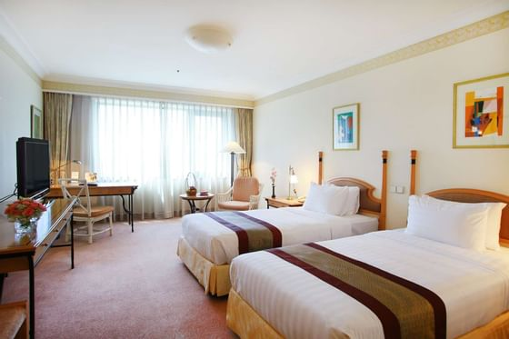 Grand Deluxe Room with two beds at Hanoi Daewoo Hotel