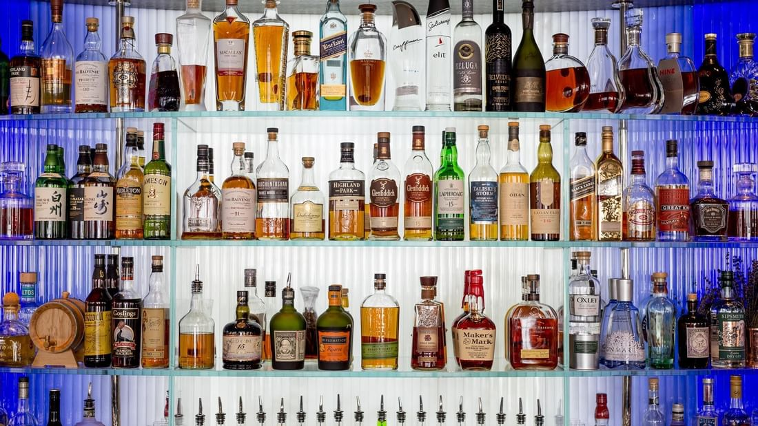 Liquor Bottles on a rack in Bar at The May Fair Hotel London
