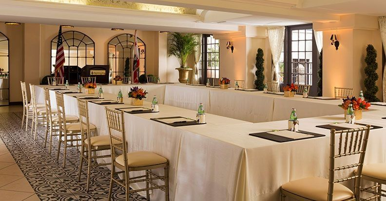 banquet room with rectangular table set up for meeting