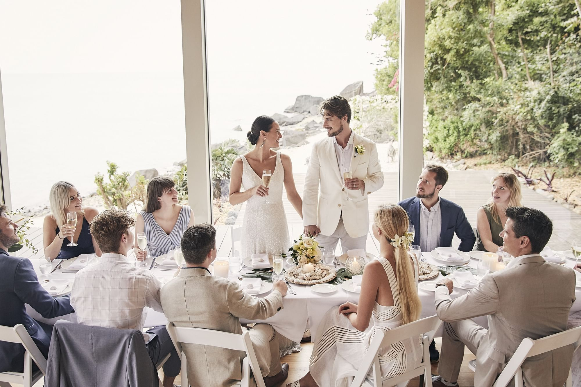 Wedded couple having a toast at Daydream Island Resort