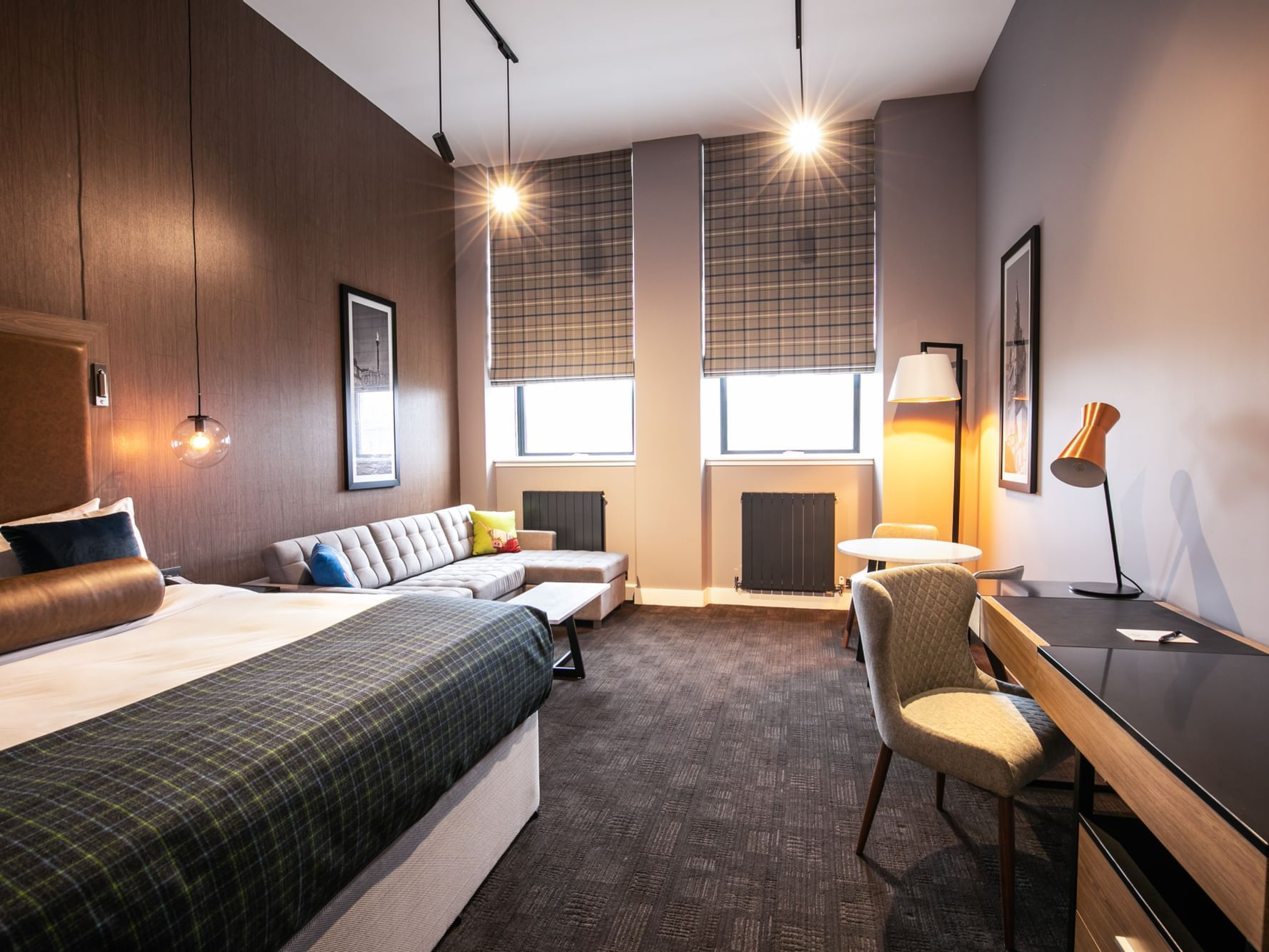 The Corporate King Room at Sandman Signature Aberdeen Hotel with one super king bed (luxury glencraft mattress) and a pull-out sofa bed on the side