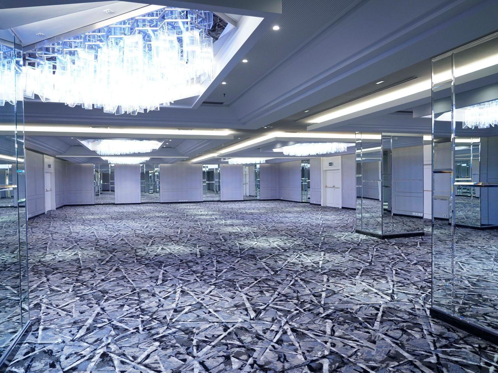 Del Prado event hall with a blue carpeted floor at Hotel Emperador Buenos Aires
