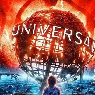a person standing in front of the globe at Universal Studios