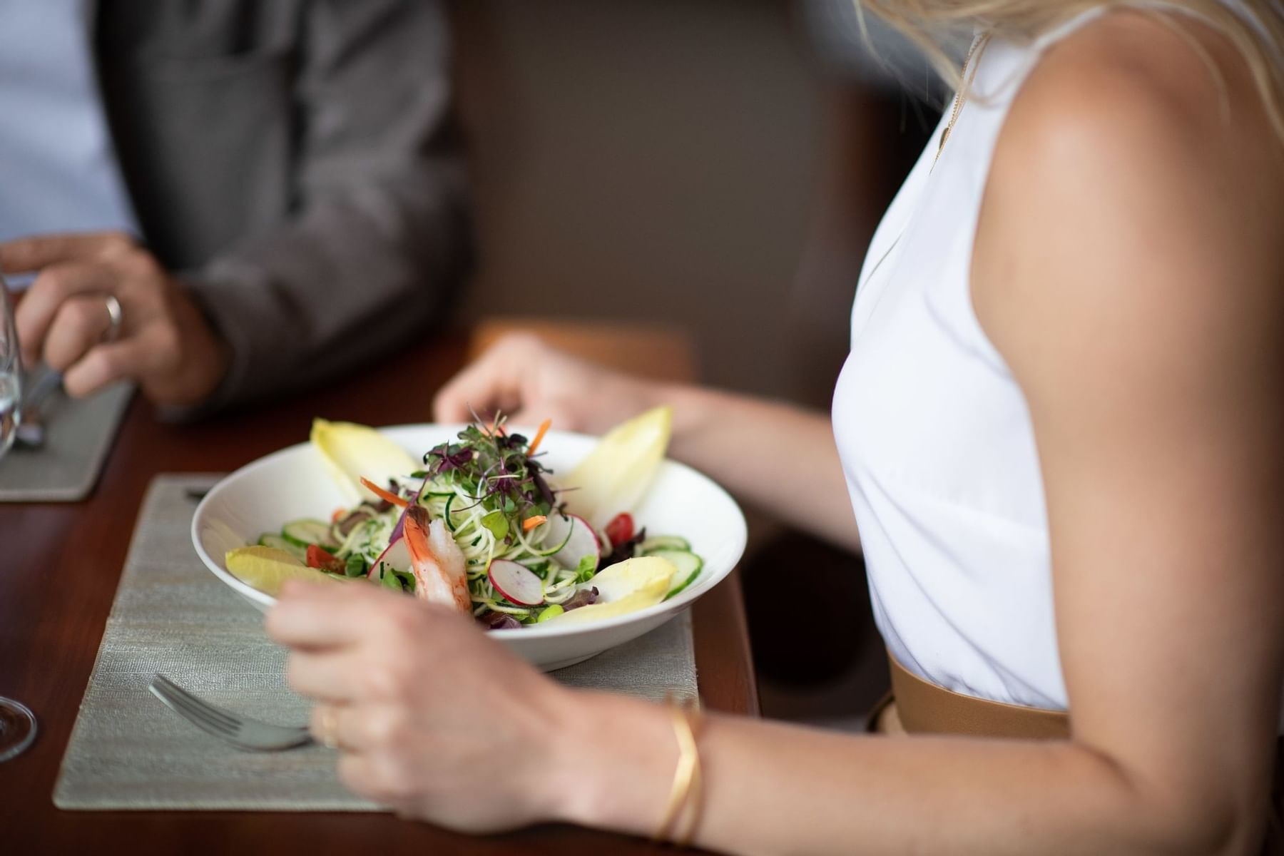 Young lady eating a salad