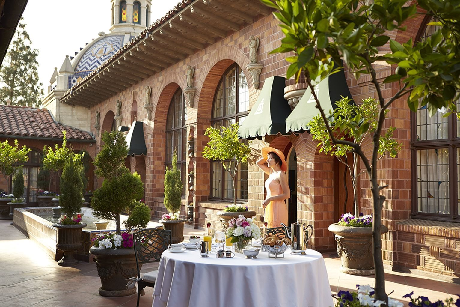 outdoor terrace with tables at Mission Inn