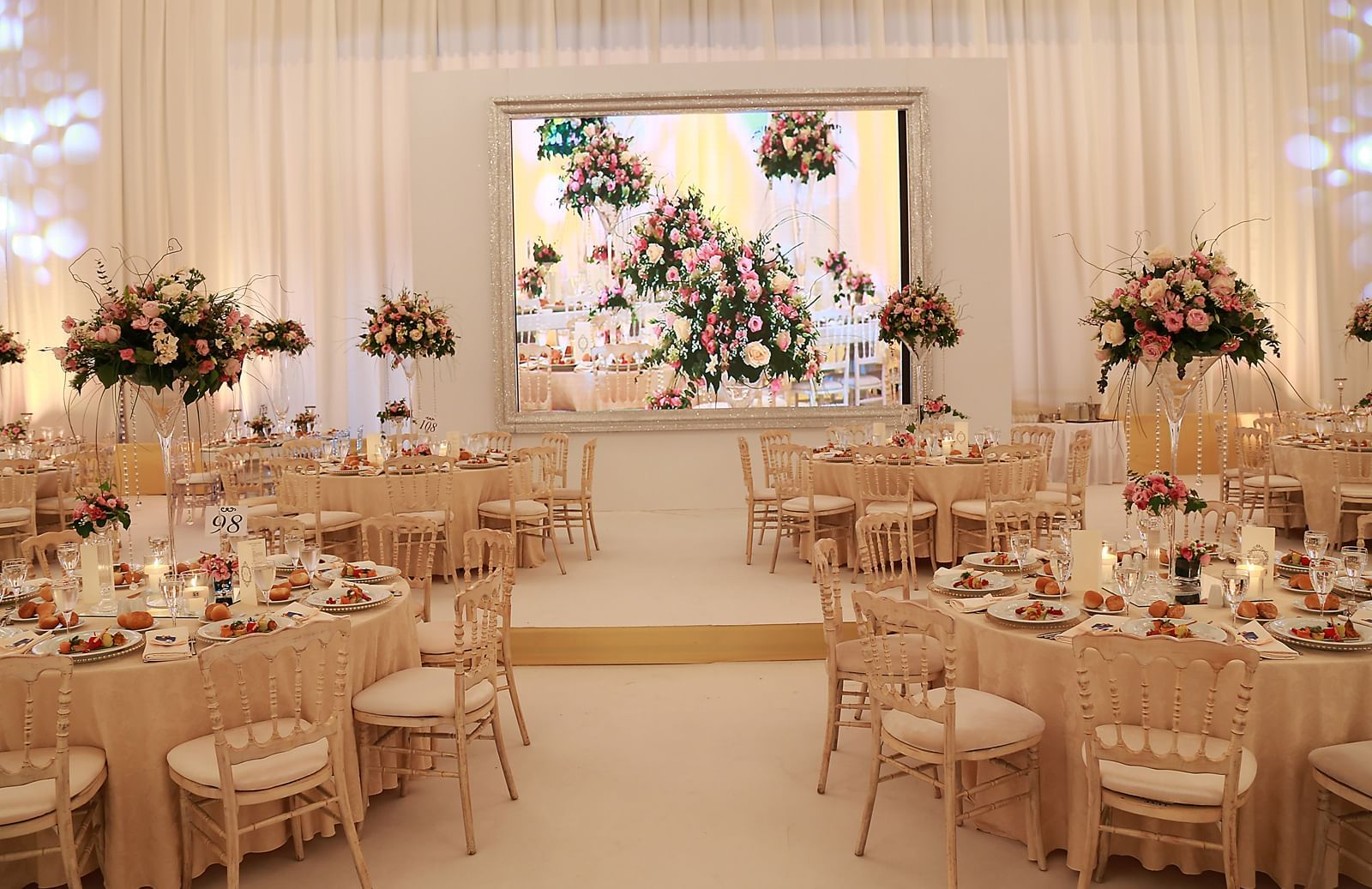 Wedding hall with round shape tables at Wow Hotels Group