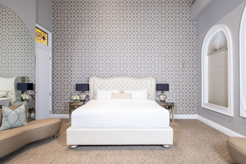 King bed in Presidential Suite Room 313 at Retro Suites historic